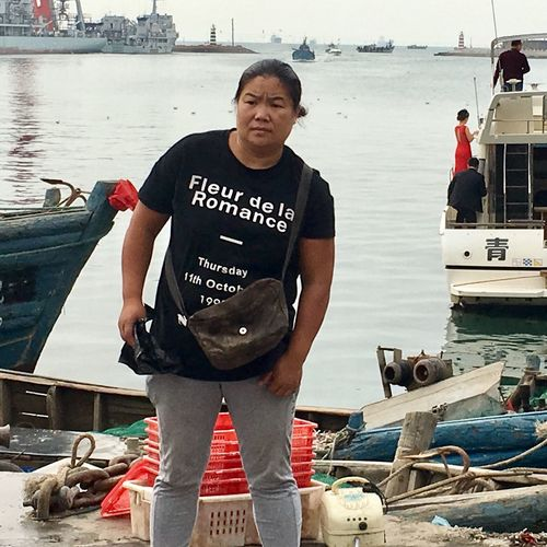 Portrait of man standing on boat in sea