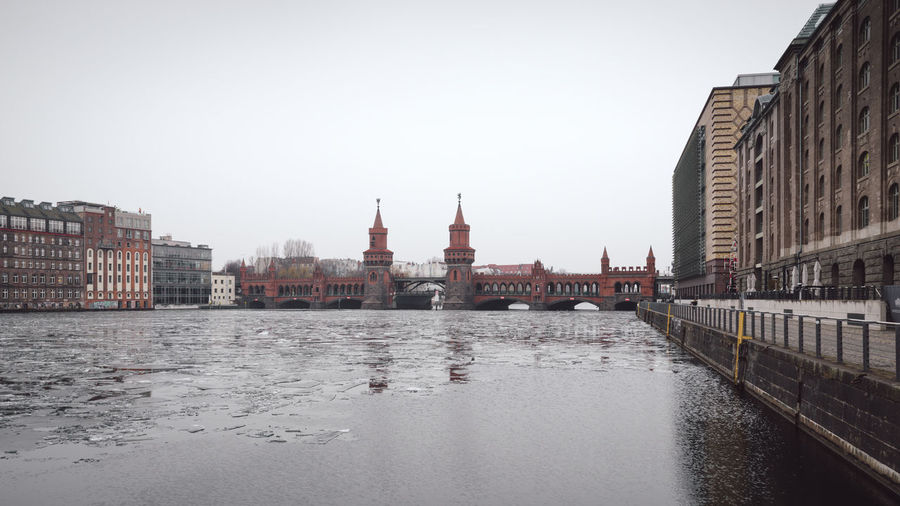 oberbaumbridge over spree river in Berlin city Berlin Berlin City Berlin Friedrichshain Cityscape Ice On The Water Oberbaumbrücke Sights & Views  Sightseeing Sightseeing Spot Winter Architecture Berlin Kreuzberg Berlinstagram Building Exterior Built Structure City Cityscape Clear Sky Day Germany No People Oberbaumbridge Outdoors Sky Urban Icon Water