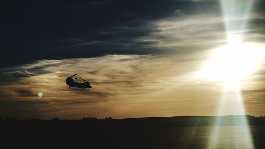 Hard Army Army Helicopter Sky Cloud - Sky Sunset Transportation Silhouette Sunlight Mode Of Transportation Air Vehicle Flying Lens Flare No People Sun Mid-air Tranquility Outdoors