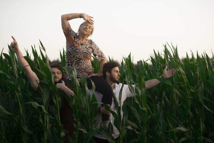 Two brothers hold their mother in the cornfield on shoulders,family portrait Sons Brothers BIG Big Children Holding Mother Mom Woman On Shoulders Shoulders Corn Field Cornwall Green Sunset Real People Leisure Activity Land Growth Sky Young Adult Two Men Lifestyle Mid Adult Family Portrait Happiness Young Women Plant Lifestyles Casual Clothing People Nature Adult Males  Human Arm Arms Raised Outdoors Three People
