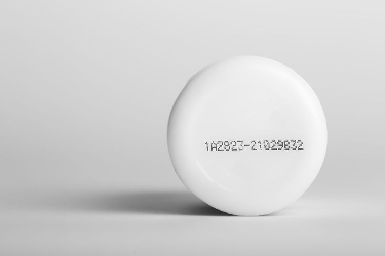 Close-up of apple over white background