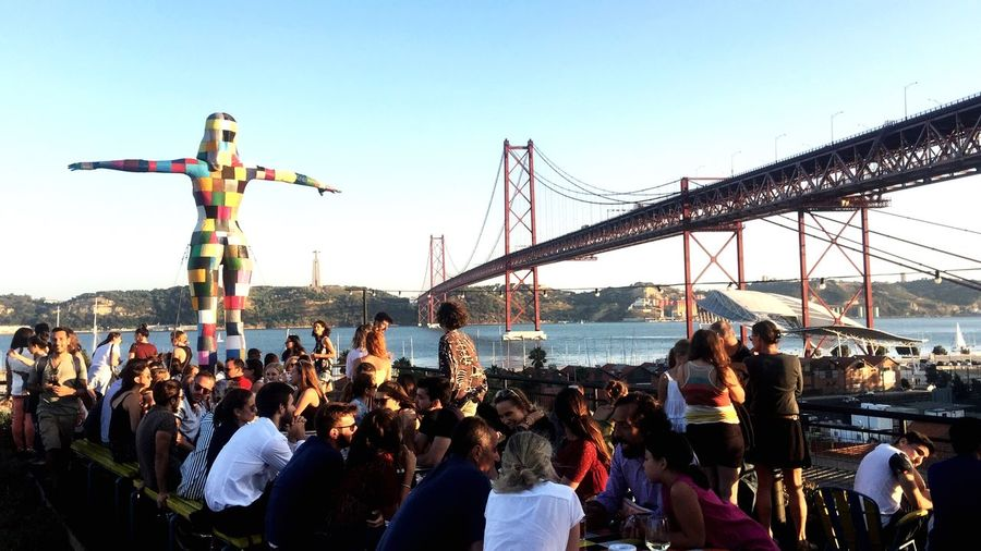 Rio Maravilha, Rooftop Lisboa Sunset Rio Maravilha Lx Factory 25 De Abril Bridge Portugal Lisbon Rooftop Crowd Group Of People Sky Large Group Of People Architecture Real People Water Travel Bridge Built Structure City Day Lifestyles