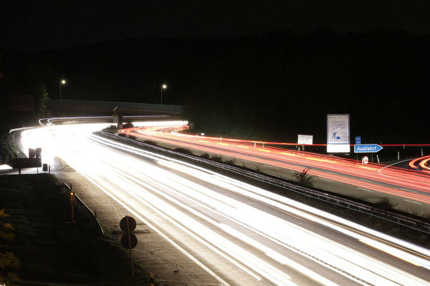 City Illuminated Motion Railroad Track Light Trail Long Exposure Speed City Life Cityscape Sky Vehicle Light Tail Light Multiple Lane Highway Highway Two Lane Highway Traffic