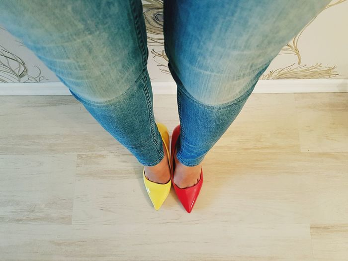 Low Section Human Leg Human Body Part High Angle View Standing Yellow Color Red Color Red Stilletos Yellow Stilletos Stilletos High Heels Jeans Bluejeans Shoes Feet Woman Feet 100 Shades Of Yellow Fashion Fashion&love&beauty Indoors  Hardwood Floor Paint The Town Yellow Red And Yellow Vibrant Colors Inner Power