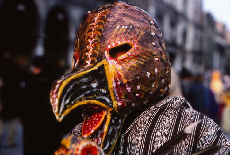 Close-up of person wearing bird mask during venice carnival