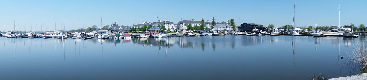 Panorama of the Marina on a Lovely Clear Spring Day. Clear Blue Sky Trees Architecture Building Exterior Clear Sky Day Harbor Lake Luxury Marina Mast Mode Of Transportation Moored Nature Nautical Vessel No People Outdoors Reflection Sailboat Sky Transportation Water Waterfront Yacht