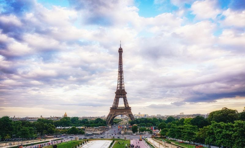 Paris France Eiffel Tower Tourism Travel Destinations Tower Famous Place Eiffel_tower  International Landmark Sky Travel Culture Tall - High Cloud - Sky Capital Cities  The Way Forward Architecture Metal History Iron - Metal Diminishing Perspective Cloudy Day sunset view over the eiffel tower