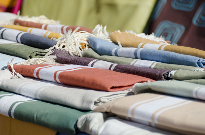 Close-up of multi colored towels on table for sale
