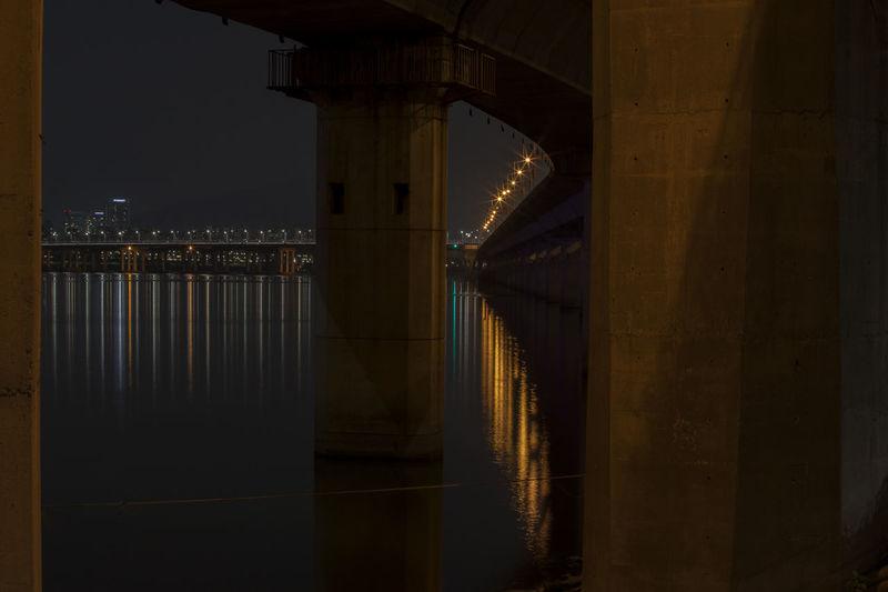 Underneath view of illuminated bridge over river han at night