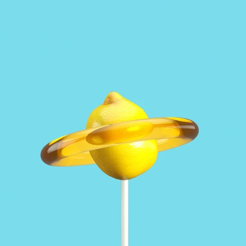 Close-up of lemon candy against blue background