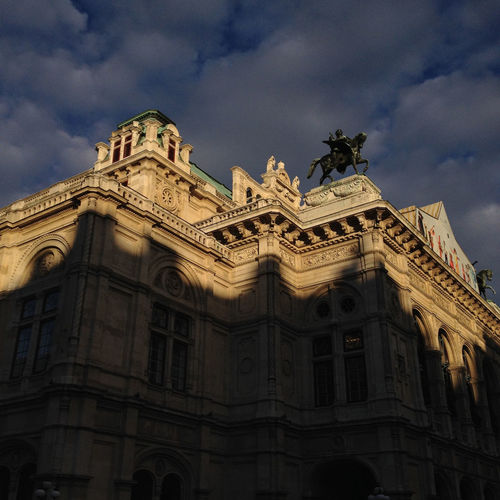 Low angle view of historical building against cloudy sky