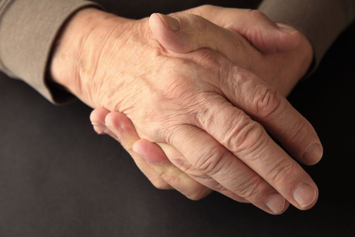 Older man holding his numb hand Aging Arthritis Black Background Close-up Condition Dark Background Discomfort Elderly Fingers Healthcare And Medicine Human Hand Human Skin Hurting Indoors  Joint Pain Natural Light Numbness Patient Senior Adult Soreness Symptom Textures Wrinkled Wrinkled Skin