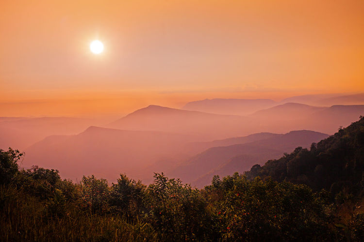 Mroning Sunset And Clouds  Sunset Astronomy Tree Mountain Sunset Dawn Fog Sun Illuminated Sky Landscape Dramatic Sky Politics And Government Orange Color Sky Only