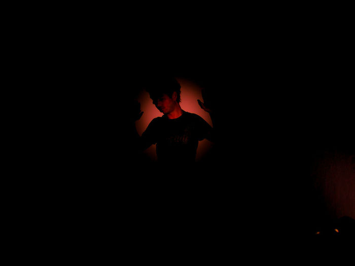 After dark Dark HUAWEI Photo Award: After Dark Light Black Background Burning Communication Copy Space Dark Domestic Room Fire Fire - Natural Phenomenon Flame Heat - Temperature Illuminated Indoors  Lifestyles One Person Orange Color Real People Shadow Sign Silhouette Studio Shot Vampire Capture Tomorrow