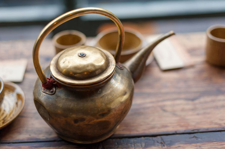 tea kettle Table Close-up Teapot Wood - Material Still Life No People Kettle Metal Focus On Foreground Old Indoors  Container Tea Kettle Shiny Kitchen Utensil Antique Handle Rusty High Angle View Steel