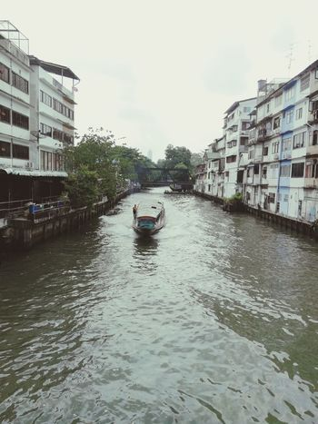 by the river Thailand Asian  Bangkok Thai City Water Nautical Vessel Apartment Residential Building Architecture Building Exterior Sky Built Structure Canal Adventures In The City