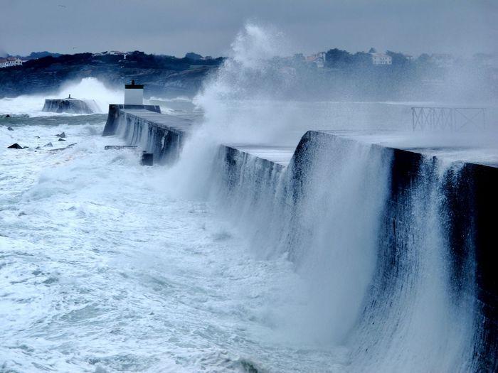 Sea waves splashing on retaining wall