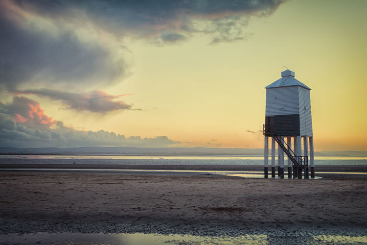 Low light Sky Sea Water Beach Cloud - Sky Sunset Built Structure Land Architecture Scenics - Nature Tower Building Exterior Safety Beauty In Nature Nature Horizon Hut Protection Horizon Over Water No People Outdoors Lighthouse