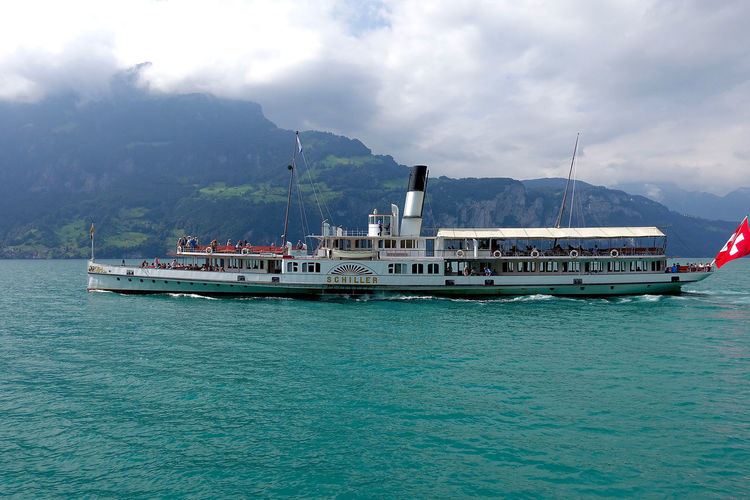 The paddle ship «Schiller» on Lake Lucerne. Cloud - Sky Cloudy Day Journey Lake Lucerne Mode Of Transport Mountain Nature Nautical Vessel Non-urban Scene Outdoors Paddle Ship Passenger Craft Scenics Schiller Tranquil Scene Tranquility Transportation Water
