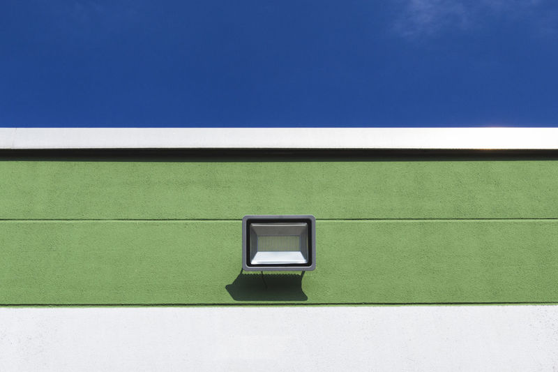 Low angle view of wall lamp against sky