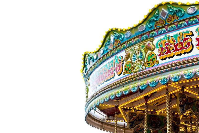 Low angle view of carousel against clear sky