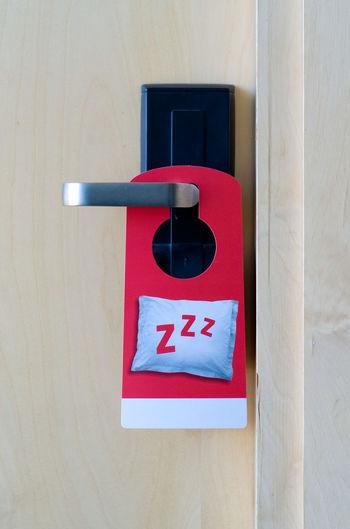 Close-Up Of Label On Door Handle