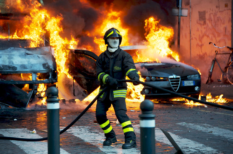fire fighter extinguishing a fire during a demonstration against Berlusconi government in Piazza del Popolo Accidents And Disasters Burning Danger Demonstration Emergency Equipment Extinguisher Fire Firefighter Flame Heat - Temperature Heroes People Piazza Del Popolo Rescue Rescue Worker Rome, Italy Resist The Photojournalist - 2018 EyeEm Awards