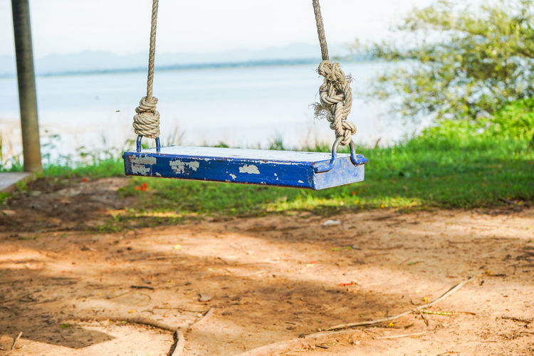Absence Day Dirt Empty Focus On Foreground Hanging Land Nature No People Outdoor Play Equipment Outdoors Park Park - Man Made Space Plant Playground Rope Sky Swing Tree Wood - Material