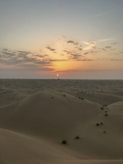 Sunrise on the ocean of dunes.... Dubai Emirates Sea Horizon Over Water Sunset Beach Beauty In Nature Scenics Nature Sand Water Tranquility Sky Tranquil Scene Outdoors No People Day Sunrise Sun Dubai Middle East Nature Desert Destination Travel Destinations Landscape Travel