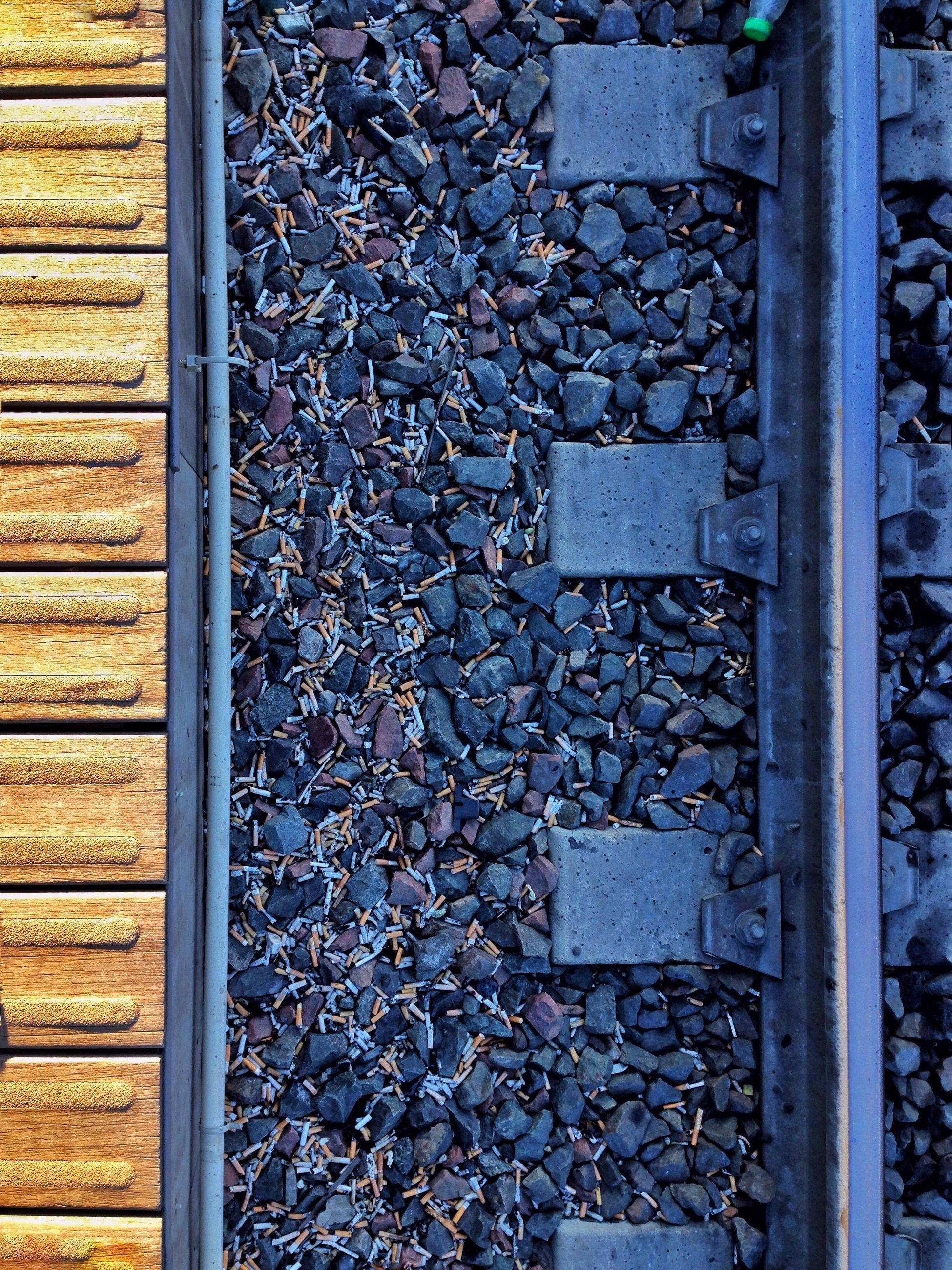 metal, stone - object, railroad track, full frame, old, metallic, weathered, rusty, backgrounds, high angle view, close-up, textured, day, wall - building feature, outdoors, no people, built structure, abandoned, pattern, deterioration