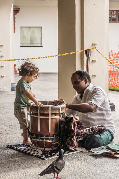 Playing the drums Two People Sitting Togetherness People Friendship Real People Day Streetphotography ASIA Belief And Faith Hinduism Everyday Life Singapur Music Kid Boy Older Man Temple Blessed  EyeEmNewHere Drum Playing Interest Generations The Street Photographer - 2017 EyeEm Awards