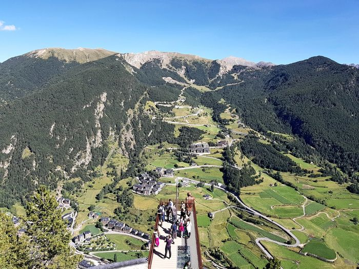 High angle view of people on mountain against sky