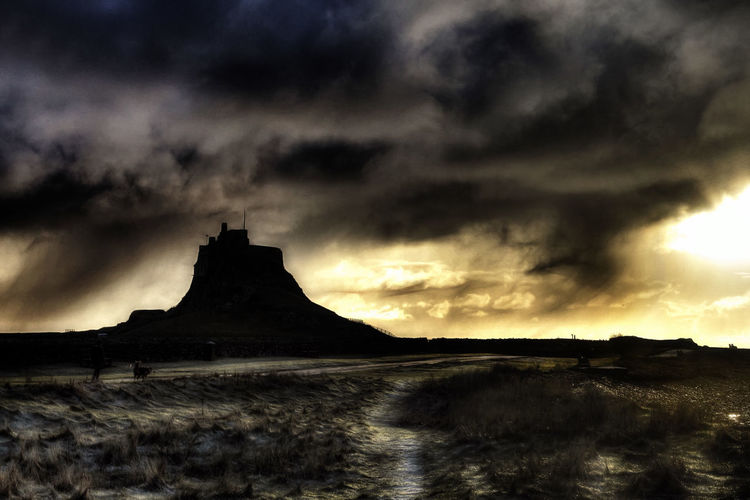 A cold morning at the castle Castle Lindisfarne Castle Winter Landscape Wintertime Beauty In Nature Castle On A Hill Cloud - Sky Day Holy Island Landscape Lindisfarne Mountain Nature No People Outdoors Scenics Silhouette Sky Storm Cloud Sunset Tranquility Water Waterfront