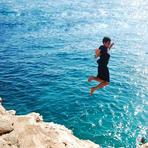 Sommergefühle Summertime Jump Freedom Dive Young Water Day Full Length Real People Childhood One Person Outdoors Fun People Sea Jumping Child Children Only Nature Adult One Boy Only EyeEm Best Shots Blues Philippines
