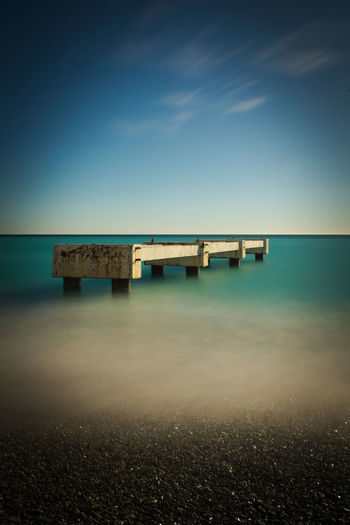 Sky Sea Water Connection Horizon Blue Horizon Over Water Nature Architecture No People Scenics - Nature Long Exposure Beach Tranquil Scene Tranquility Land Outdoors Bridge Built Structure The Architect - 2019 EyeEm Awards