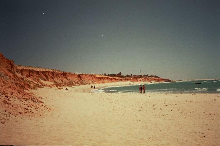 Sand Beach Sea Real People Sky Nature Beauty In Nature People Outdoors Large Group Of People Sand Dune Vacations Travel Destinations Brasil Argentique Analogue Photography Analog Hapiness