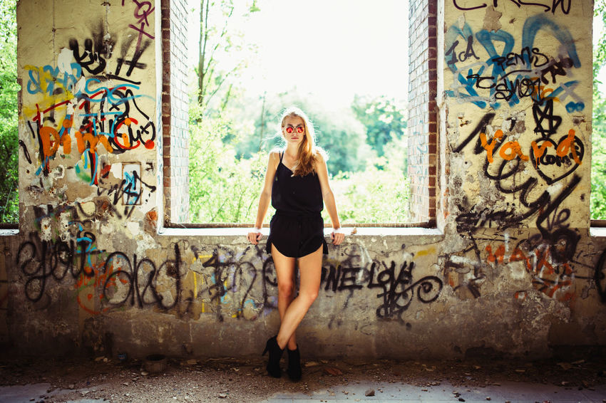 Frozen Moment Abandoned Abandoned Buildings Abandoned Places Architecture Art Backlight Brick Wall Built Structure Casual Clothing Day Front View Graffiti Indoors  Lifestyles Model Portrait Standing Sunglasses Wall Wall - Building Feature Young Adult