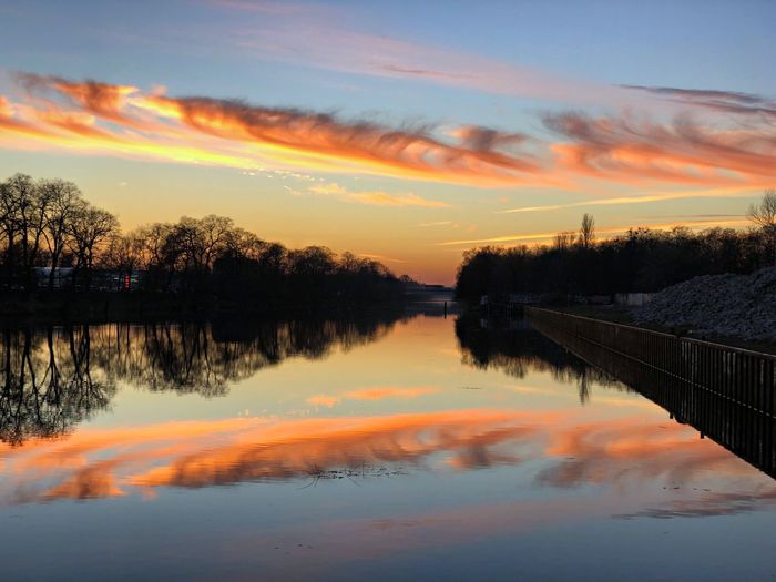 Reflection of clouds in the water during sunset Cloud Reflection On Water Cloud Reflections Sunset Clouds Dusk Sunset Over Water Sunset In Berlin Sunset Reflection Water Sky Sunset Lake Tranquility Scenics - Nature Beauty In Nature Cloud - Sky Tranquil Scene Orange Color Nature No People Idyllic Silhouette Waterfront Outdoors