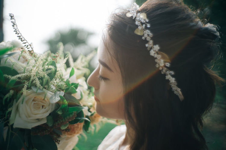 Close-Up Of Bride With Bouquet