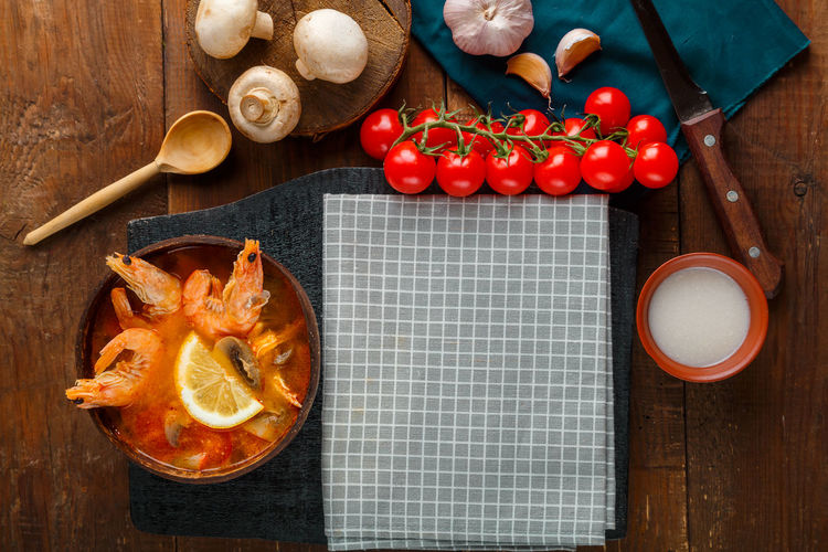 High angle view of fruits on cutting board