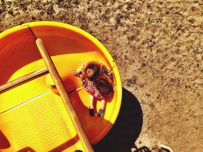 High angle view of girl on slide at playground