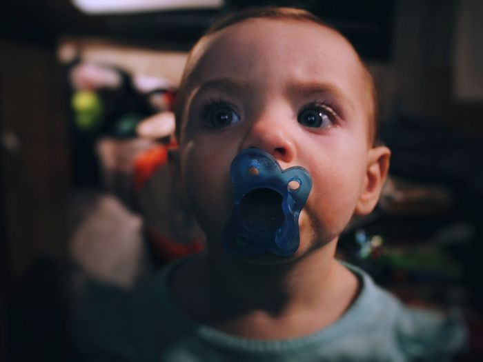 Close-up of cute girl with pacifier