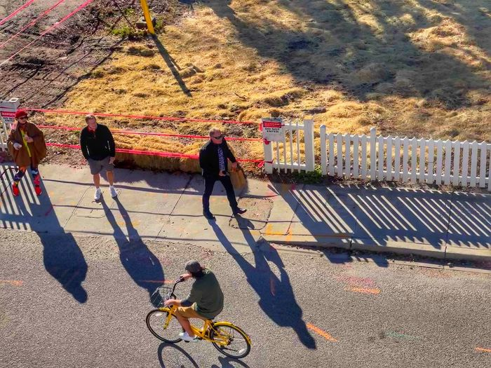 High angle view of people riding bicycle