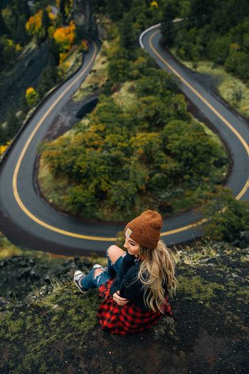 Lost In The Landscape One Person Only Women Adult One Woman Only People Sitting Nature One Young Woman Only Young Adult Outdoors Leisure Activity Day Full Length Tree Women Young Women Mountain Beauty In Nature Blond Hair