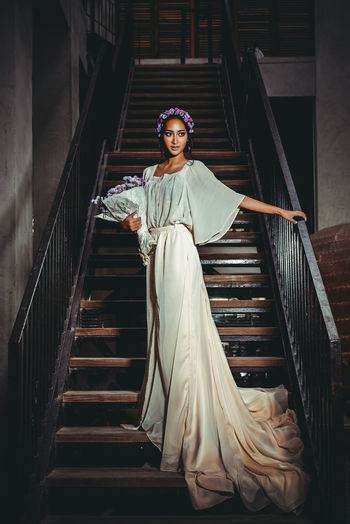 Beautiful Bride Wearing Gown While Standing On Steps