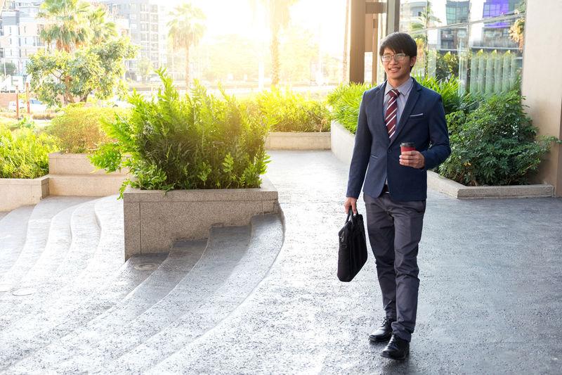 Portrait Of Businessman Walking In City