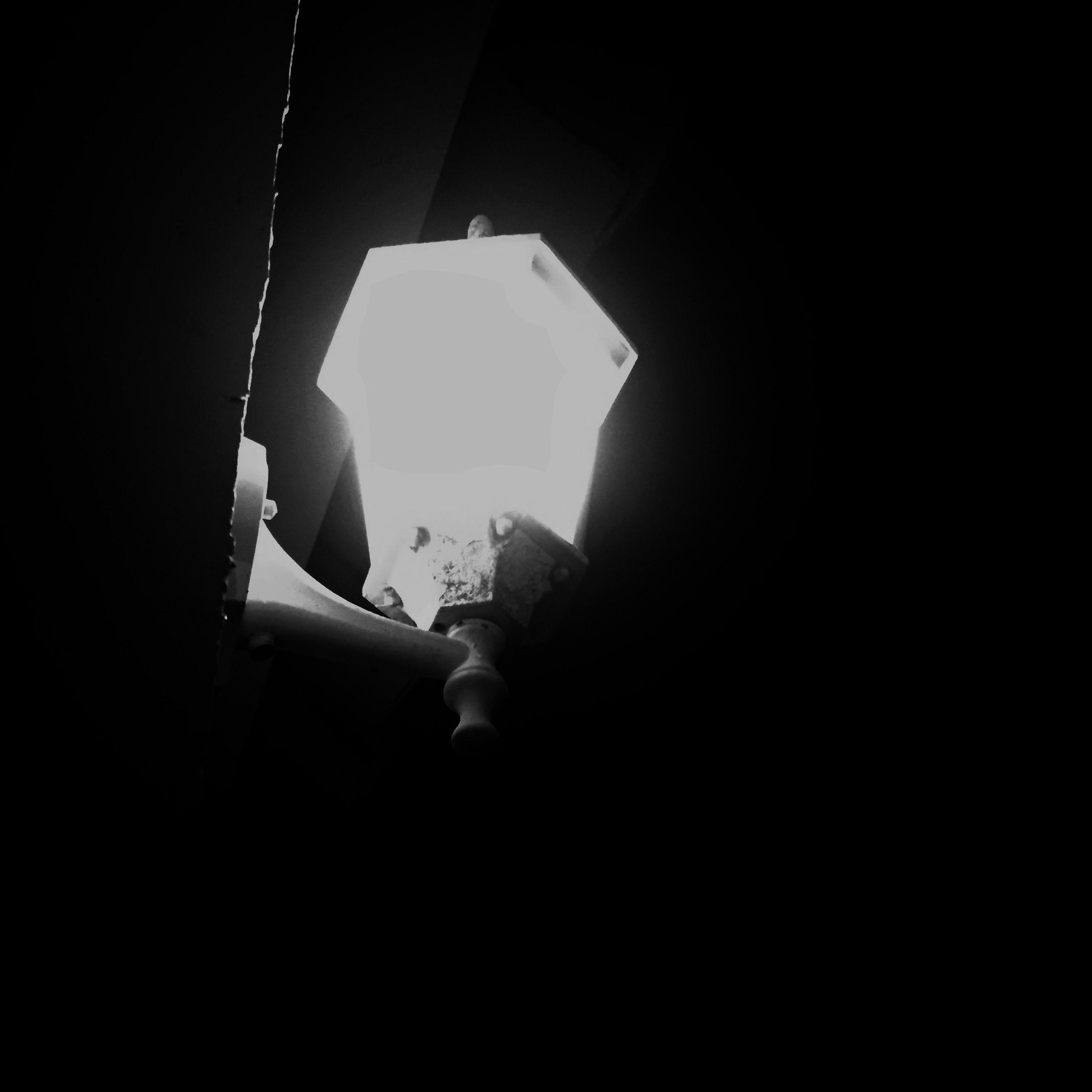 indoors, holding, lifestyles, person, men, dark, copy space, leisure activity, home interior, part of, window, sitting, cropped, darkroom, black background, side view, studio shot