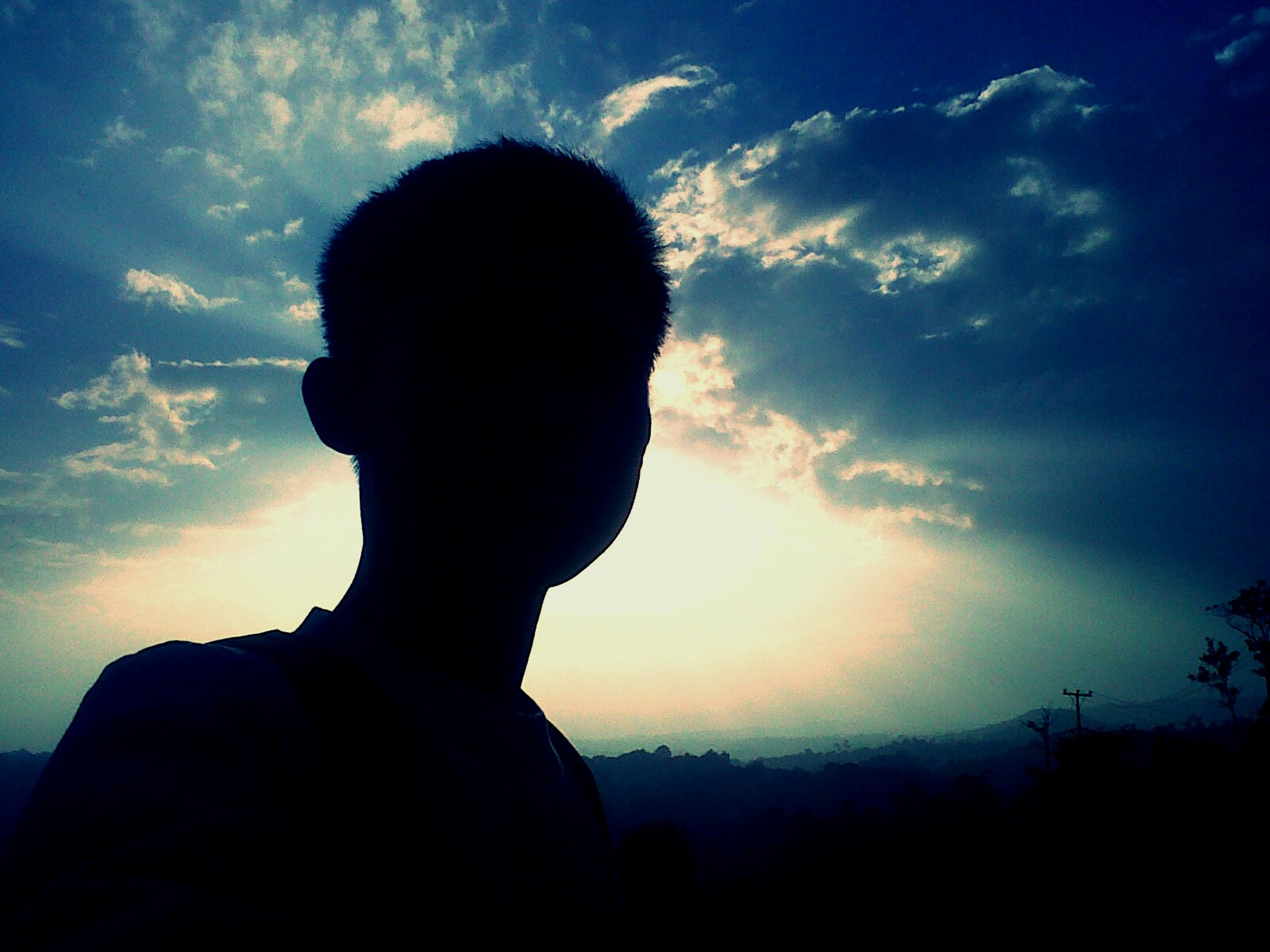 silhouette, sky, lifestyles, sunset, leisure activity, cloud - sky, men, waist up, rear view, three quarter length, cloud, standing, low angle view, sun, nature, person, beauty in nature, sunlight