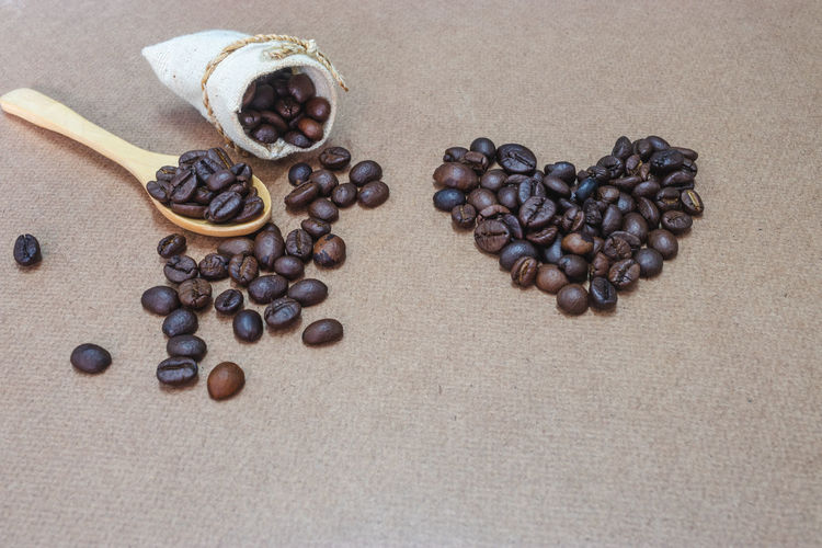 Food And Drink Food Roasted Coffee Bean Coffee Coffee - Drink Brown Freshness Indoors  Table Still Life Large Group Of Objects No People High Angle View Directly Above Close-up Spilling Caffeine Drink Abundance Refreshment Non-alcoholic Beverage