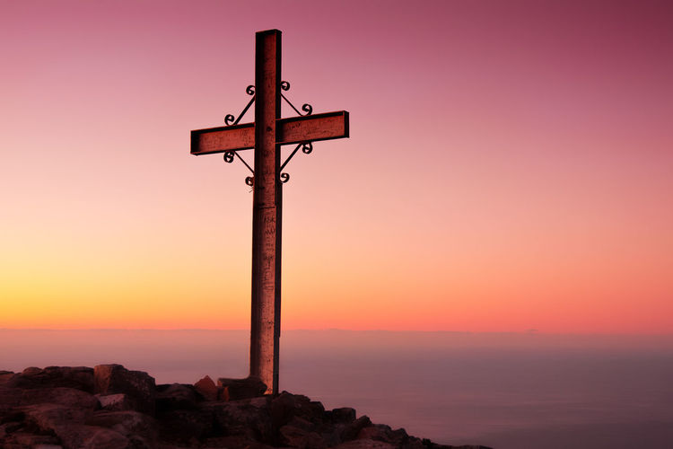 Cross Against Clear Sky During Sunset